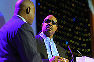 August 24, 2011 (Washington, DC)  Superstar songwritter Stevie Wonder makes remarks at the Honoring Global Leaders for Peace Gala at the Washington Convention Center, as Harry E. Johnson, Sr., CEO of the MLK Memorial Foundation looks on.  The event kicked off week-long activities leading up to the dedication of the Martin Luther King Jr. Memorial on Sunday, August, 28, 2011.  (Photo by Don Baxter/Media Images International)
