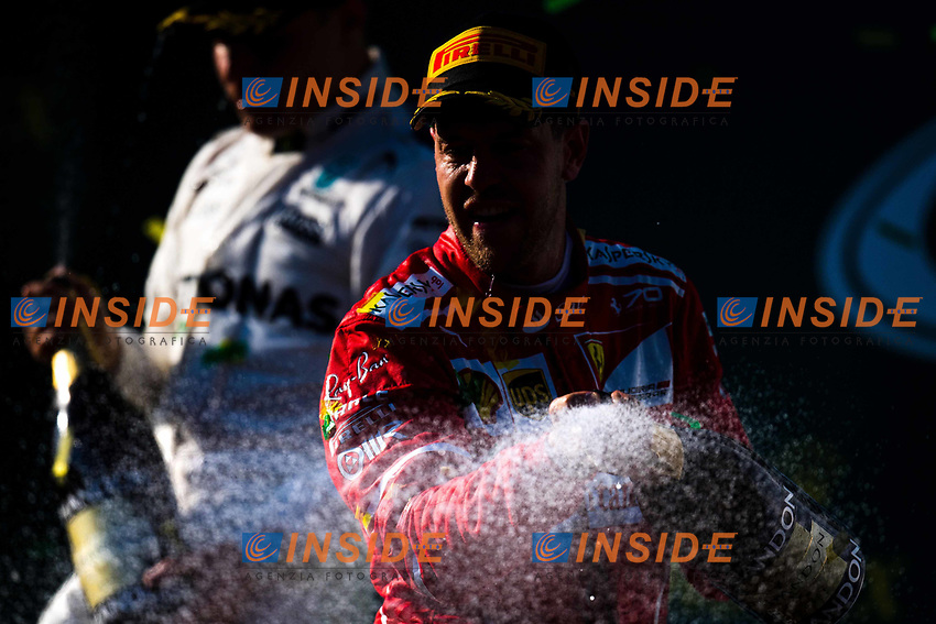 Race winner Sebastian Vettel (GER) Ferrari celebrates on the podium with the champagne at Formula One World Championship, Rd1, Australian Grand Prix, Race, Albert Park, Melbourne, Australia, Sunday 26 March 2017.<br /> Foto Sutton/Panoramic/Insidefoto