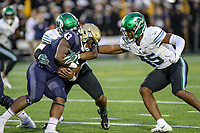 Annapolis, MD - October 26, 2019: Navy Midshipmen fullback Nelson Smith (43) gets tackled by several Tulane Green Wave defenders during the game between Tulane and Navy at  Navy-Marine Corps Memorial Stadium in Annapolis, MD.   (Photo by Elliott Brown/Media Images International)