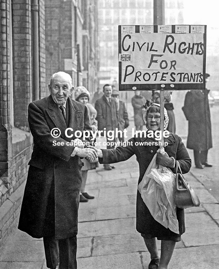 Lord Brookeborought, 1st Viscount, previously known as Sir Basil Brooke, former Prime MInister of N Ireland, arriving at the Ulster Unionist Party's headquarters in Glengall Street, Belfast, N Ireland, shakes hands with a placard-carrying supporter of the Rev Ian Paisley. The legend on the placard was Civil Rights for Protestants. The purpose of the Unionist Party meeting was to give members the opportunity to support a vote of confidence in Prime Minister, Captain Terence O'Neill. 196903070086<br /> <br /> Copyright Image from Victor Patterson,<br /> 54 Dorchester Park, Belfast, UK, BT9 6RJ<br /> <br /> t1: +44 28 90661296<br /> t2: +44 28 90022446<br /> m: +44 7802 353836<br /> <br /> e1: victorpatterson@me.com<br /> e2: victorpatterson@gmail.com<br /> <br /> For my Terms and Conditions of Use go to<br /> www.victorpatterson.com