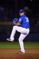 Tulsa Drillers pitcher Ralston Cash (30) delivers a pitch during a game against the Midland RockHounds on June 2, 2015 at Oneok Field in Tulsa, Oklahoma.  Midland defeated Tulsa 6-5.  (Mike Janes/Four Seam Images)