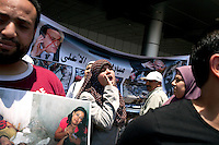 Sarah, Sister Rhada's daughter, protests against the former Prime Minister of Mubarak, Ahmed Shafik, who was at that moment in the run-off against Mohammad Morsi for the Presidency. The demonstration was in front of the Cairo airport, a project headed by Ahmed Shafik that is the currently at the the centre of much controversy. Cairo, Egypt. June 11th, 2012.