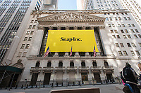 The New York Stock Exchange is decorated for the technology company Snap's initial public offering on Thursday, March 2, 2017. Snap, the parent of Snapchat, the popular disappearing messaging app, debuted with a valuation of $24 billion and is the largest technology ipo since Alibaba in 2014., (© Richard B. Levine)