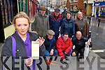 Rachel Touhy who is furious with a parking ticket she received in Main Street after running into Sheahan's Pharmacy for medicine for her child front row l-r: John McCarthy, Eileen McSharry, James O'Riordan. Back row: Liam Sheahan, Con Murphy, Eileen Ahern and Bernie Leahy