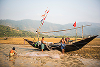 Fishermen preparing fishing boats and nets at Tizit Beach, Dawei Peninsula, Tanintharyi Region, Myanmar (Burma)