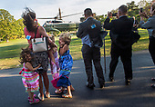 The D'Amico family watches as Marine One, carrying United States President Donald Trump, lands on the South Lawn of the White House, in Washington, D.C. on April 18, 2017. Trump was returning from a day trip to Wisconsin where he visited Snap-on tools. <br /> Credit: Kevin Dietsch / Pool via CNP