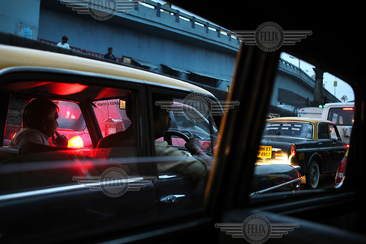 Taxis stuck in a traffic jam in Mumbai city center. In 2002 all diesel engine taxis in Mumbai had either to be phased out or converted to compressed natual gas (CNG) or liquefied petroleum gas (LPG). With over 50000 cabs in Mumbai, this measure has improved the air quality in the city.