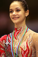 Irina Tchachina of Russia performs split leap handsfree with chiffon during gala at finish of World Championships in Baku, Azerbaijan on October 9, 2005. (Photo by Tom Theobald)<br />