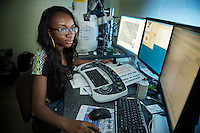 Research Experiences for Undergraduates (REU) student Peace Adeyemo of University of Memphis looks at calcified cells scanned by the Scanning Electron Microscope (SEM) at MSU's Institute for Imaging and Analytical Technologies, or I2AT. Adeyemo is working with LaShan Simpson, an MSU professor of agriculture and biological engineering, to research vascular calcification. Funding for the REU program allows MSU to bring in undergraduate researchers from other universities. A number of students became regular visitors this summer, as their research required use of I2AT's electron microscopes.<br />