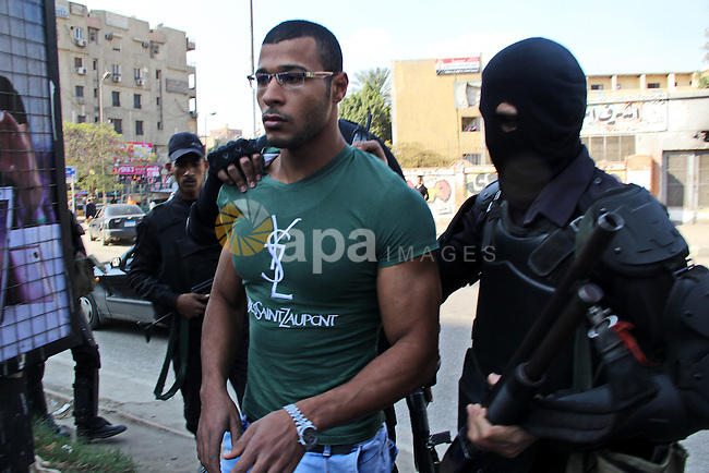 Egyptian police arrest a protester who support Muslim Brotherhood during a protest on al-Haram Street, Cairo, Egypt, 28 November 2014. According to unconfirmed reports at least two Egyptian army officers have been killed and soldiers injured in seperate incidents in Egypt, as some hardline Salafi Muslims heeded calls to hold protests against what they see as the secularisation of Egyptian society and the proliferation of indecent activities, to which Egyptian authorities responded by tightening security measures throughout the country and it has been alleged killing an as yet unconfirmed number of protesters. Photo by Amr Sayed