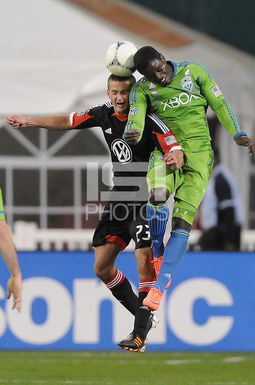 D.C. United midfielder Perry Ktichen (23) heads the ball against Seattle Sounders forward Eddie Johnson (7) D.C. United tied the Seattle Sounders, 0-0 at RFK Stadium, Saturday April 7, 2012.