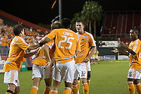 Houston Dynamo players Richard Mulrooney (8), Stuart Holden (22), Brian Ching (25), Bobby Boswell (32) and Corey Ashe (26) celebrate a goal.  Houston Dynamo defeated San Jose Earthquakes 2-1 at Robertson Stadium in Houston, TX on October 15, 2008.  Photo by Wendy Larsen/isiphotos.com