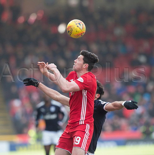 17th March 2018, Pittodrie Stadium, Aberdeen, Scotland; Scottish Premier League football, Aberdeen versus Dundee; Scott McKenna of Aberdeen out-jumps Sofien Moussa of Dundee
