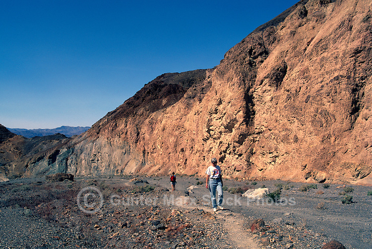 Death Valley National Park, California, CA, USA - Hikers hiking on Trail through Mosaic Canyon in Tucki Mountain (Model Released Person in foreground)