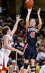 SIOUX CITY, IA - MARCH 13, 2009 --  Cathryn Wiebe #41 of Sterling College shoots over Becca Hurley #14 of Northwestern College (IA) during their game at the 2009 NAIA DII Women's Basketball National Championship at the Tyson Events Center. (Photo by Dick Carlson/Inertia)