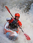 November 5, 2016 - Hendersonville, North Carolina.  A kayaker in the midst of the Scream Machine rapids prior to the 21st annual Green Race.The Green River Narrows provides one of the most intense and extreme whitewater venues in the world and is home to many of the USA's most talented paddlers.  Green River Narrows, Hendersonville, North Carolina.
