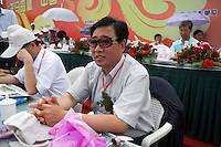 A judge looks on at the Red Games. Held in Junan County, this sporting event is a nostalgic tribute to the communist era.
