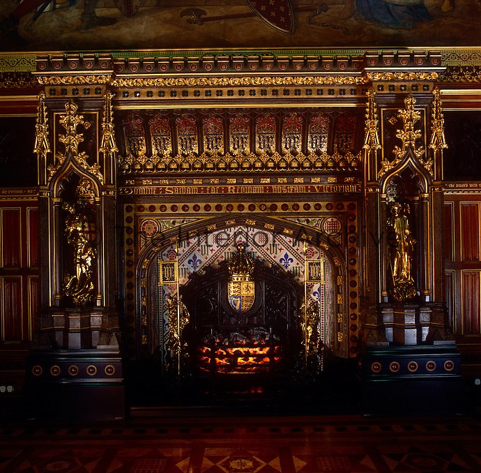 The opulent fireplace in the Queen's Robing Room, was designed by Edward Barry, in the richly gilded and patterned Victorian Gothic manner