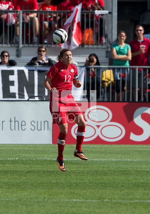 02 June 2013: Canadian Woman's National Team forward Christine Sinclair #12 in action during an International Friendly soccer match between the U.S. Women's National Soccer Team and the Canadian Women's National Soccer Team at BMO Field in Toronto, Ontario.<br /> The U.S. Women's National Team Won 3-0.