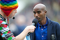 Mo Farah, Olympic double gold medallist, is interviewed on the pitch at half time about the Mo Farah Foundation during the Aviva Premiership match between Harlequins and Saracens at the Twickenham Stoop on Sunday 30th September 2012 (Photo by Rob Munro)