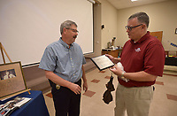 NWA Democrat-Gazette/BEN GOFF @NWABENGOFF<br /> Ken Farmer (left), Bella Vista Police Chief, talks with citizens Friday, May 19, 2017, during a retirement ceremony and reception for Farmer at American Legion Post  341 in Bella Vista. Farmer began his law enforcement career in 1978 with the Benton County Sheriff's Office, working in the sheriff's office Bella Vista Division. Farmer started as a captain with the Bella Vista Police Department after the city incorporated in 2007, and became the department's chief in October 2009. James Graves has been hired as incoming chief, and will take over full responsibility as chief on June 1.
