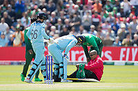 Jason Roy (England) checks to ensure Joel Wilson, Umpire  is OK after Roy inadvertently collided with him during England vs Bangladesh, ICC World Cup Cricket at Sophia Gardens Cardiff on 8th June 2019