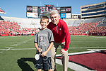 Wisconsin Badgers Honorary Captain Pat Richter with junior captain during an NCAA Big Ten Conference football game against the Maryland Terrapins Saturday, October 21, 2017, in Madison, Wis. The Badgers won 38-13. (Photo by David Stluka)