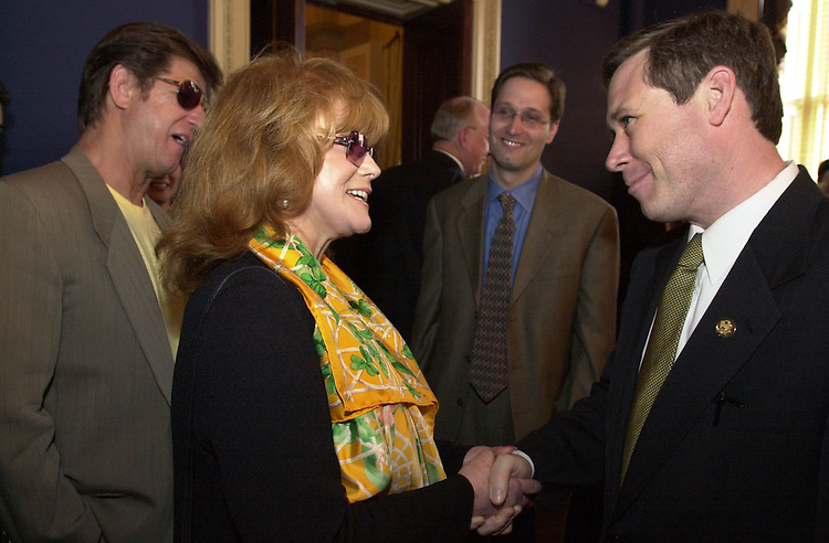 1Margret050801-- Actress Ann Margret greets Rep. Mark Kirk, R-IL, at a recepitopn in which she received a lifetime achievement award from the Recording Industry.