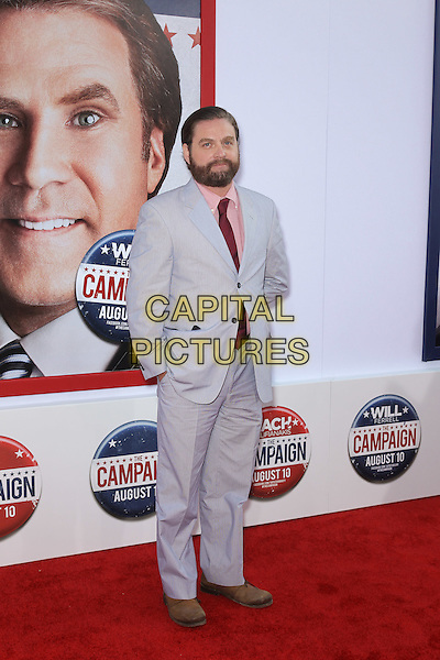 "ZACH GALIFIANAKIS.Los Angeles premiere of Warner Brothers Pictures' ""The Campaign,"" at Grauman's Chinese Theatre in Hollywood. Hollywood, CA., USA. .August 2nd, 2012.full  length suit blue red tie pink shirt beard facial hair .CAP/CEL .©CelPh/Capital Pictures."