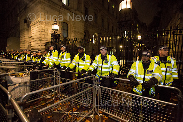 Downing Street.<br /> <br /> London, 05/11/2015. Thousands of protesters gathered this evening in central London to take part in a demonstration called the &quot;Million Mask March&quot;, which is organised annually by Anonymous, and held globally in more than 400 cities planned to coincide with Guy Fawkes Night (The Gunpowder Plot of 1605). The aim of the demo was to highlight social injustice and Government corruption across the globe, but also to protect the environment, freedom of the internet, oppose mass surveillance and austerity. The rally started in Trafalgar Square, and then the protesters marched on Whitehall, gathering in Parliament Square. Around 7:00pm, a large group marched towards Great George street where clashes erupted with police officers in full riot gears, supported by police dogs and mounted police. Then, the demonstration carried on towards Victoria (where a police car was set on fire), Buckingham Palace and The Mall, to end in the Trafalgar Square area, where the police contained the last activists in &quot;kettles&quot; until around 11:30pm.<br /> <br /> For more information please click here: http://on.fb.me/1mcn5Z7