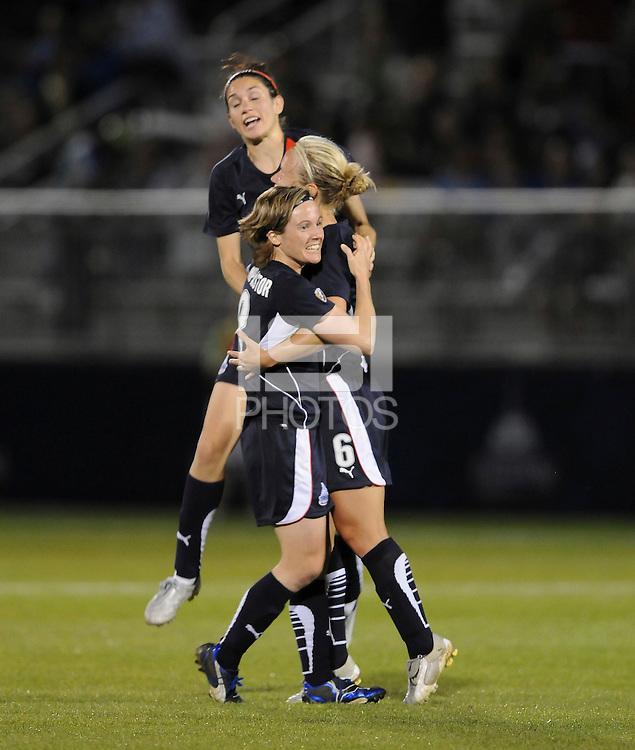 Washington Freedom midfielder Lori Lindsey (6) celebrates her goal with teammates Sonia Bompastor (8) and Alex Singer (21). Boston Breakers defeated Washington Freedom 3-1  at The Maryland SoccerPlex, Saturday April 18, 2009.
