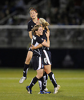 Washington Freedom midfielder Lori Lindsey (6) celebrates her goal with teammates Sonia Bompastor (8) and Alex Singer (21). Boston Breakers defeated Washington Freedom 3-1  at The Maryland SoccerPlex, Saturday April 18, 2009.