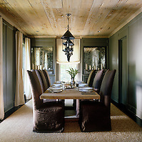 In the dining room, the unexpected textures of the raw wood ceiling and time-worn Belgian dining table add a lived-in European romance