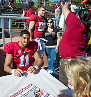 SAN FRANCISCO, CA - April 14, 2012: Levine Toilolo (11) and Stanford fan at the Stanford Cardinal and White Spring Game at Kezar Stadium in San Francisco, CA.