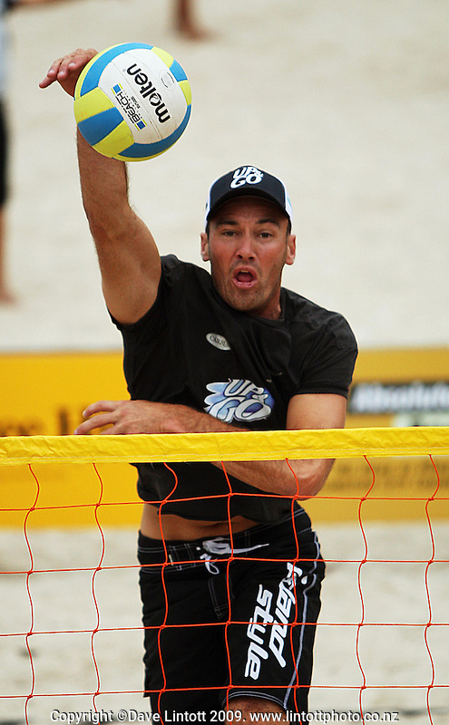 NZ's Kirk Pitman plays a shot at the net in his and Jason Lochhead's opening match against Ben Glue and Pat Shone during the 2009 McEntee Hire NZ Beach Volleyball Tour day one matches at Oriental Parade, Wellington, New Zealand on Saturday, 10 January 2009. Photo: Dave Lintott / lintottphoto.co.nz