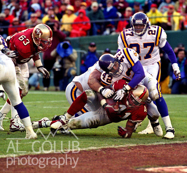 San Francisco 49ers vs. Minnesota Vikings at Candlestick Park Saturday, January 3, 1998.  49ers beat Vikings  38-22.  Minnesota Vikings defensive back Orlando Thomas (42) stops San Francisco 49ers running back Terry Kirby (41) at the goal line.