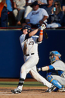 Chad Wallach #29 of the Cal State Fullerton Titans bats in front of Shane Zeile #14 of the UCLA Bruins during the NCAA Super Regional at Goodwin Field on June 7, 2013 in Fullerton, California. UCLA defeated Cal State Fullerton, 5-3. (Larry Goren/Four Seam Images)