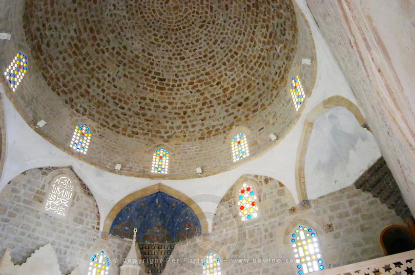 Inside of the renovated mosque. The domed ceiling and stained glass windows. Pocitelj historic Muslim and Christian village near Mostar. Federation Bosne i Hercegovine. Bosnia Herzegovina, Europe.