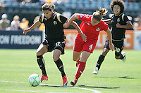 Christine Sinclair (12) and Cat Whitehill (4) battle for the ball. FC Gold Pride defeated Washington Freedom 3-2 at Buck Shaw Stadium in Santa Clara, California on August 1, 2009.
