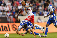 Thierry Henry (14) of the New York Red Bulls looks to get past Matt Hedges (24) of FC Dallas. The New York Red Bulls defeated FC Dallas 1-0 during a Major League Soccer (MLS) match at Red Bull Arena in Harrison, NJ, on September 22, 2013.