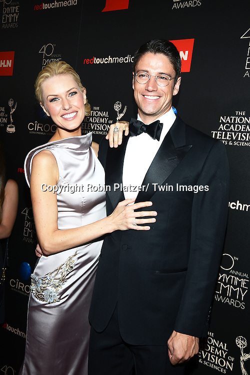 James Scott and girlfriend Kaitlin Robinson attend The 40th Annual Daytime Emmy Awards on<br />