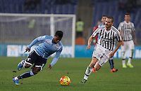 Calcio, Serie A: Lazio vs Juventus. Roma, stadio Olimpico, 4 dicembre 2015.<br /> Juventus&rsquo; Paulo Dybala, right, celebrates with teammate Lazio&rsquo;s Keita Balde Diao, left, is chased by Juventus&rsquo; Leonardo Bonucci during the Italian Serie A football match between Lazio and Juventus at Rome's Olympic stadium, 4 December 2015.<br /> UPDATE IMAGES PRESS/Isabella Bonotto