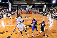 12 November 2010:  FIU's Eric Frederick (15) lays up the ball for a basket as Florida Memorial's Matthew Rolle (24) and La Dante Berry-White (5) watch in the second half as the FIU Golden Panthers defeated the Florida Memorial Lions, 89-73, at the U.S. Century Bank Arena in Miami, Florida.