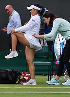 England, London, 25.06.2014. Tennis, Wimbledon, AELTC, Kurimi Nara (JPN) gets a fysio treatment<br /> Photo: Tennisimages/Henk Koster