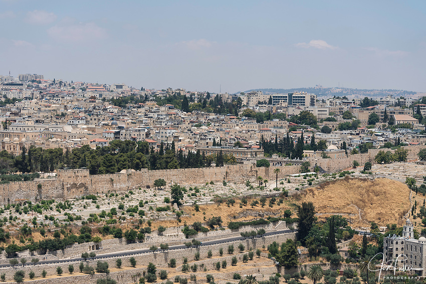 The Temple Mount or al-Haram ash-Sharif  with the Golden Gate or East Gate in the old city wall.  Behind is the Muslim Quarter of the Old City.  The Old City of Jerusalem and its Walls is a UNESCO World Heritage Site.