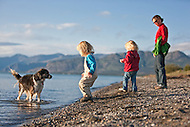 Writer Teresa Earle and her daughters enjoying the beach at Kluane Lake, Yukon near Kluane Lake Research Station