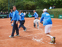 09-06-13, Tennis, Netherlands,The Hague, Playoffs Competition, The winners team the Lobbelaer spraying champagne