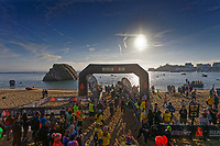Pictured: Swimmers at the finish line of the swim event on the north beach. Sunday 15 September 2019<br /> Re: Ironman triathlon event in Tenby, Wales, UK.