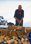 Man making wooden clogs, Gouda, South Holland, Netherlands,