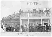Posed photo of attendees at ball in front of Mutz Hotel in Elizabethtown, NM.<br /> Elizabethtown, NM  Taken by Consaul &amp; Sweetland, - 1896